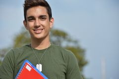 Hispanic Male Teen Military Student And Happiness royalty free stock image