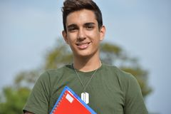 Hispanic Male Teen Military Student And Smiling. A young hispanic male teen Royalty Free Stock Photo