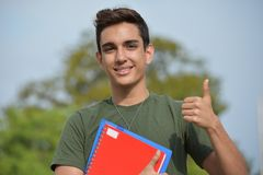 Hispanic Male Teen Military Student And Success. A handsome hispanic male teen Royalty Free Stock Images