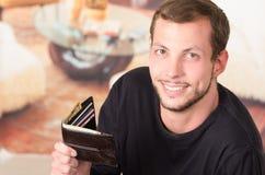 Hispanic male wearing dark sweater looking into Royalty Free Stock Photos