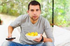 Hispanic male wearing light blue sweater plus Stock Images