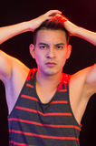 Hispanic male wearing red black striped singlet Royalty Free Stock Images
