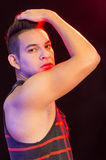 Hispanic male wearing red black striped singlet Stock Photos