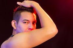 Hispanic male wearing red black striped singlet Stock Photo