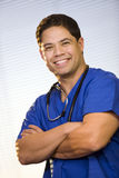 Hispanic Male Wearing Scrubs. Close-up of handsome male in the medical field wearing scrubs and stethoscope around neck Stock Photography