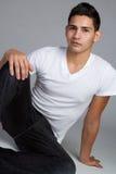 Hispanic Man. Young hispanic man sitting royalty free stock photography