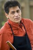 Hispanic man barbecuing Stock Photos