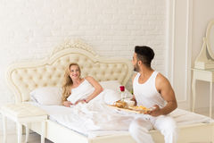 Hispanic Man Bring Breakfast To Woman In Morning Tray With Red Rose Flower Stock Image