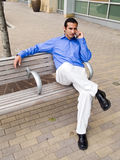 Hispanic man on cell phone Stock Photo