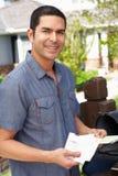 Hispanic Man Checking Mailbox Royalty Free Stock Photo