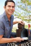 Hispanic Man Checking Mailbox Royalty Free Stock Image