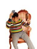 Hispanic man coming his hair. Stock Photography