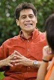 Hispanic man conversing royalty free stock image