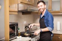 Hispanic man cooking at home Royalty Free Stock Photos
