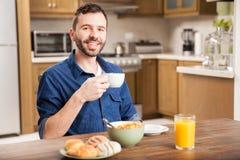 Hispanic man eating breafast at home Stock Photos