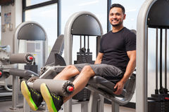 Hispanic man enjoying leg day at the gym stock photography