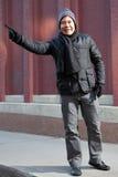 Hispanic man hailing a taxi Royalty Free Stock Photo