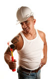 Hispanic man with hammer Stock Images