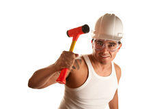 Hispanic man with hammer Royalty Free Stock Image