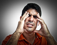 Hispanic man with a headache Stock Photos