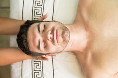 Hispanic man in a health spa. Top view of an attractive Hispanic young men relaxing in a health spa Royalty Free Stock Images