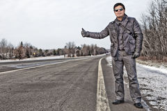 Hispanic man hitchhiking in Canada Stock Photos