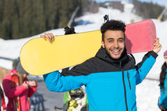 Hispanic Man Hold Snowboard Ski Resort Winter Snow Mountain Cheerful Happy Smiling Guy Stock Image