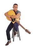 Hispanic man holding his guitar. Stock Images