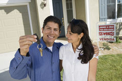Hispanic Man Holding House Keys royalty free stock image