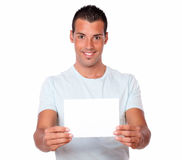 Hispanic man holding up a blank card Stock Photo