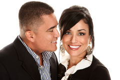 Hispanic man kissing Latina woman Stock Image