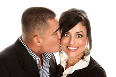 Hispanic man kissing pretty woman Royalty Free Stock Photography
