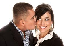 Hispanic man kissing pretty woman Stock Photos