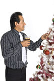 Hispanic man looking at a decorated Christmas Tree Stock Photography