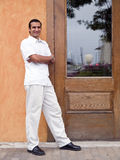 Hispanic man next to door Royalty Free Stock Photo
