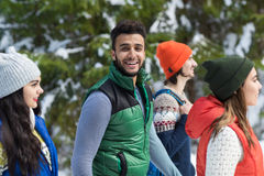 Hispanic Man People Group Snow Forest Young Friends Walking Outdoor Winter. Pine Woods stock photography