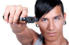 Hispanic man Pointing Gun at Camera Royalty Free Stock Image