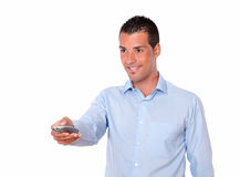 Hispanic man pointing with remote control Stock Images