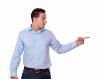 Hispanic man pointing to his left Stock Photography