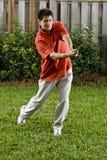 Hispanic man practice golf swing Royalty Free Stock Images