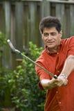 Hispanic man practicing golf swing Royalty Free Stock Photos
