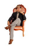 Hispanic man relaxing in a armchair. Stock Images