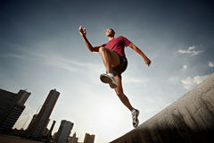 Hispanic man running and jumping from a wall royalty free stock photo