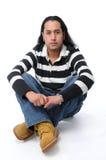 Hispanic Man Sitting Stock Photography