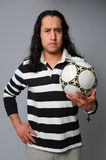 Hispanic man with soccer ball Stock Photography