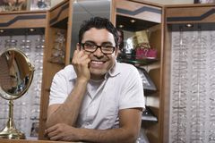 Hispanic Man In Spectacles Shop Stock Photography