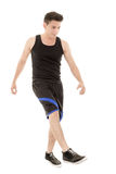 Hispanic man in sporty outfit kicking Royalty Free Stock Photography