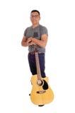 Hispanic man standing with guitar. Stock Image