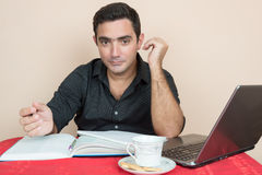 Hispanic man studying at home Royalty Free Stock Photos