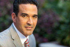 Hispanic man in suit outside Stock Image